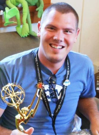 Andy with one of Jim Henson's emmys.